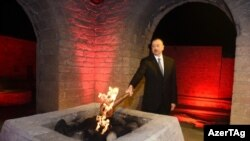 Azerbaijan - President Ilham Aliyev lights flame of the first European Games, Baku, 26Apr2015.