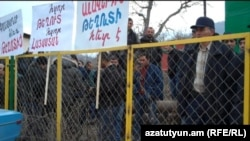 Armenia - Employees of a mining company demonstrate against environmentalists at Teghut forest, 15Jan2012.