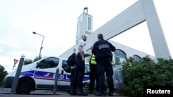 France -- Police secure a mosque in Creteil near Paris, June 29, 2017