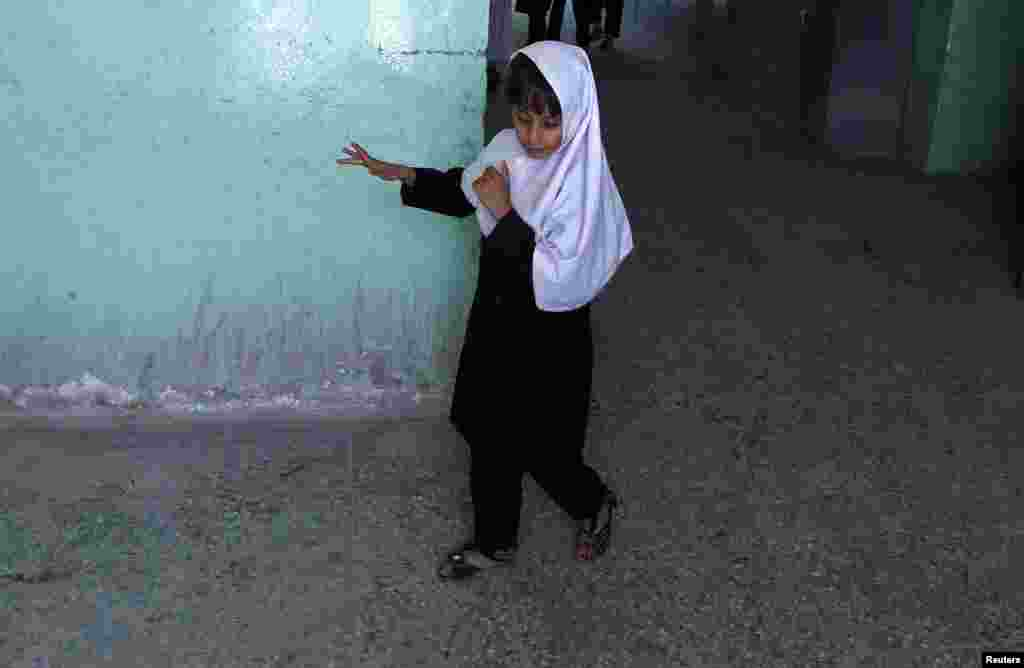 A blind student walks at the Kabul school.