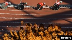 Паралимпийские состазания на фоне олимпийского огня