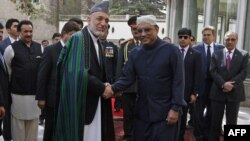 Afghan President Hamid Karzai and his Pakistani counterpart, Asif Zardari, were trying to overcome mutual distrust on the first day of talks in Istanbul.