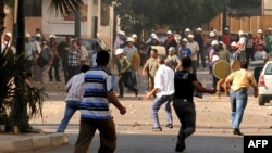 Supporters and opponents of Egyptian President Muhammad Morsi clashed in Alexandria on June 28.