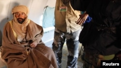 Saif al-Islam Qaddafi is pictured sitting in a plane in Zintan on November 19.