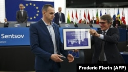 FRANCE – Ukrainian filmmaker Oleh Sentsov (left) receives the 2018 European Parliament's Sakharov human rights prize from European Parliament President David-Maria Sassoli during an award ceremony at the European Parliament in Strasbourg, November 26, 2019.