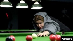 Iran -- Iranian women's snooker champion Akram Mohammadi Amini, 26, plays a shot during a practice session in Karaj, northwest of Tehran, December 8, 2015