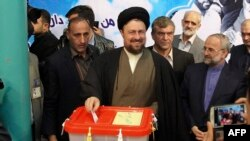 Ahmad Khomeini suggested that those behind the controversy were targeting his father, Hassan Khomeini (center).