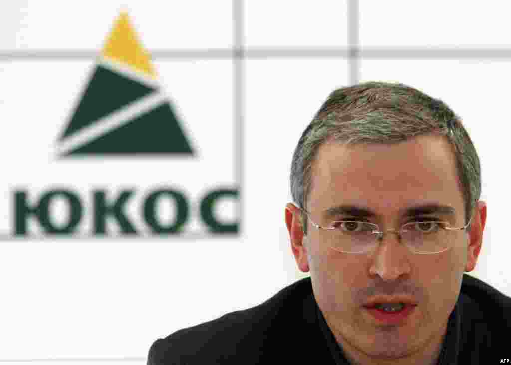 Khodorkovsky speaks at the Yukos headquarters in Moscow in June 2003, months before his arrest on fraud and tax evasion charges.