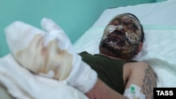 Is this Russian soldier Dorzhi Batomunkuyev in a Donetsk burn unit, or not?