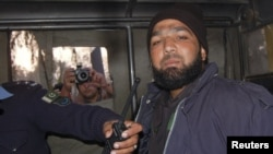 Malik Mumtaz Hussain Qadri, a bodyguard who killed Punjab Governor Salman Taseer, is photographed after being detained at the site of Taseer's shooting in Islamabad on January 4, 2011.