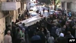 Mourners on January 3 carry the coffin of a man identified in a statement by the antiregime Local Coordination Committees as Abdel Jabbar Zaarur, reportedly killed in Homs.