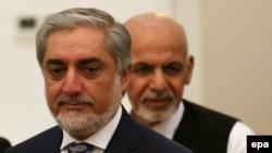 Abdullah Abdullah (L) and Ashraf Ghani (R) attend a ceremony after signing a power-sharing agreement at the Presidential Palace in Kabul, Afghanistan, 21 September 2014.