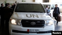 A UN vehicle carrying a chemical weapons investigation team in Damascus (file photo)