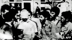 A blindfolded U.S. hostage is paraded by his captors at the compound of the U.S. Embassy in Tehran in November 1979.