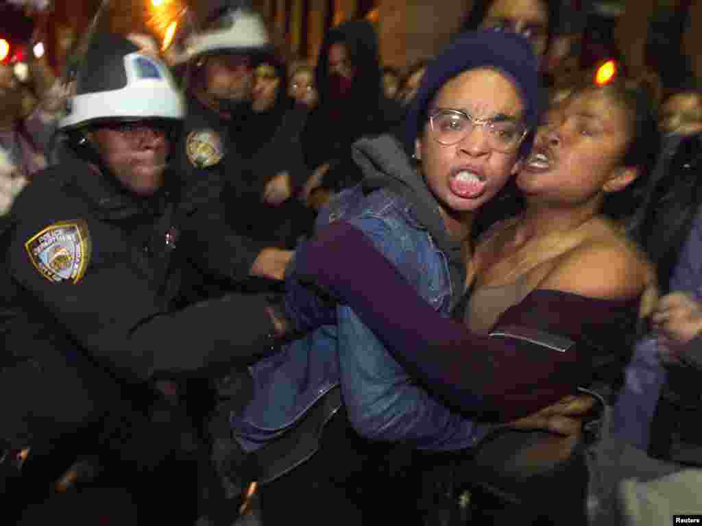 Members of the Occupy Wall Street movement clash with New York Police Department officers after being removed from Zuccotti Park in New York on November 15. (REUTERS/Lucas Jackson)