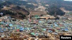 Case distruse după bombardamentul de artilerie nor-corean pe insula Yeonpyeong