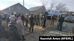 Their homes and the houses of their relatives in the central town of Oktyabrske were also searched.