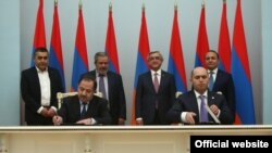 Armenia -- The ruling Republican Party and Armenian Revolutionary Federation sing a power-sharing agreement, Yerevan, 24Feb2016