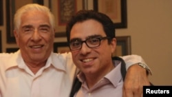 Iranian-American consultant Siamak Namazi (R) is pictured with his father Baqer Namazi, undated