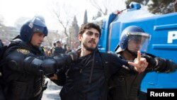 Azerbaijan -- Riot police detain a protester during a rally in Baku, 10Mar2013