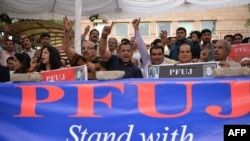 Journalists from The Pakistan Federal Union of Journalists (PFUJ) shout slogans during a demonstration in support of English daily newspaper Dawn in Islamabad in May.