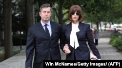 Sam Patten (left), a former associate of Paul Manafort, leaves the U.S. District Court in Washington, D.C. on August 31.