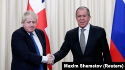 British Foreign Secretary Boris Johnson (left) and his Russian counterpart, Sergei Lavrov, held talks in Moscow on December 22.