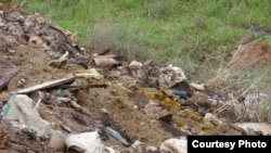 Armenia -- Hazardous chemicals under open skies in waste disposal site in Nubarashen, Yerevan, undated