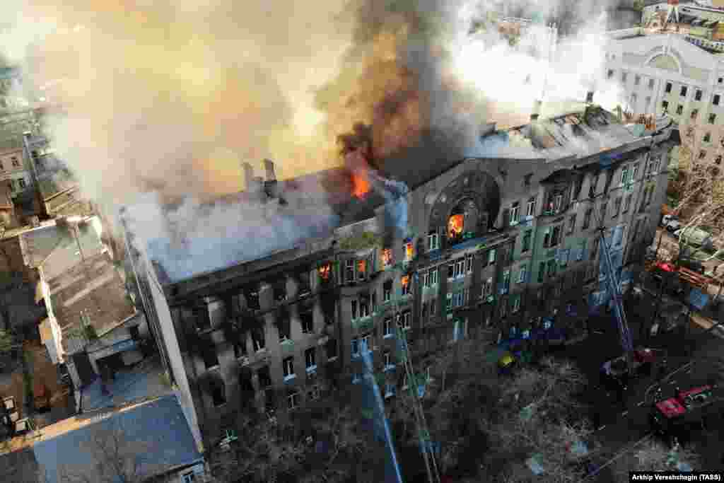 Ukrainian firefighters try to extinguish a fire engulfing a college building in central Odesa. (TASS/Arkhip Vereshchagin)