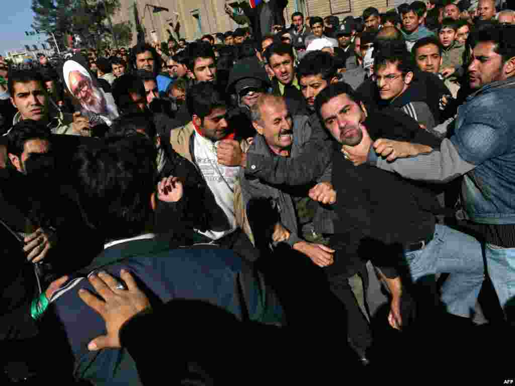 Opposition activists and supporters of Supreme Leader Ayatollah Ali Khamenei clash during the funeral.