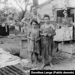 A woman and her children living in poverty in Oklahoma in 1936.