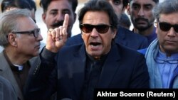 Imran Khan gestures as he addresses members of the media after Pakistan's Supreme Court dismissed a petition to disqualify him from parliament for not declaring assets, outside Jinnah International Airport in Karachi on December 15.