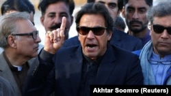 PAKISTAN -- Imran Khan, chairman of the Pakistan Tehreek-e-Insaf (PTI) political party, gestures as he addresses members of the media, after Pakistan's Supreme Court dismissed a petition to disqualify him from parliament for not declaring assets, outside