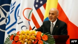 Afghan President Ashraf Ghani speaks during the opening of the Fourth Istanbul Process conference on the reconstruction of Afghanistan in Beijing on October 31.
