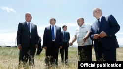 Armenia -- Minister of Agriculture Sergo Karapetian (L) and Prime Minister Hovik Abrahamian (second from left) visit a wheat field in Shirak region, 9 July, 2014