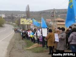 On March 8, 2014, as many as 15,000 protesters -- mainly women and children -- lined roadways throughout Crimea waving Ukrainian and Tatar flags and holding posters calling for peace.