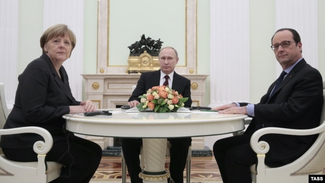 German Chancellor Angela Merkel (left to right), Russian President Vladimir Putin, and French President Francois Hollande are pictured during a meeting in the Kremlin, in Moscow, on February 6.