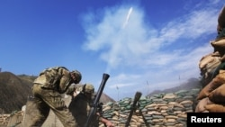 U.S. soldiers fire a mortar rounds at suspected insurgent positions in the Pech River valley in Kunar Province (file photo).
