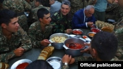 Nagorno-Karabakh - Armenian Prime Minister Tigran Sarkisian (second from right) dines with soldiers, 2Sep2013.