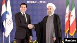 Relations between Ashgabat and Tehran have soured somewhat since this picture was taken of Iranian President Hassan Rohani (right) shaking hands with his Turkmen counterpart Gurbanguly Berdymukhammedov during the Gas Exporting Countries Forum (GECF) in the Iranian capital in November 2015.