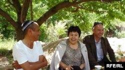 Mutabar Tojibaeva (center) celebrates after her release