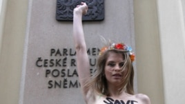 "In what she describes as a ""cry of despair,"" Hagen protested topless in front of the Czech parliament building earlier this month."