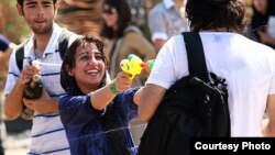 Young people fight with water guns in a park in Tehran last month.