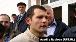 Adnan Hajizade speaks to reporters after being released from jail in Baku.