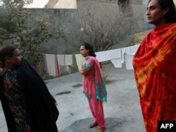 Pakistani hijras stand in the courtyard of their joint house in Rawalpindi.