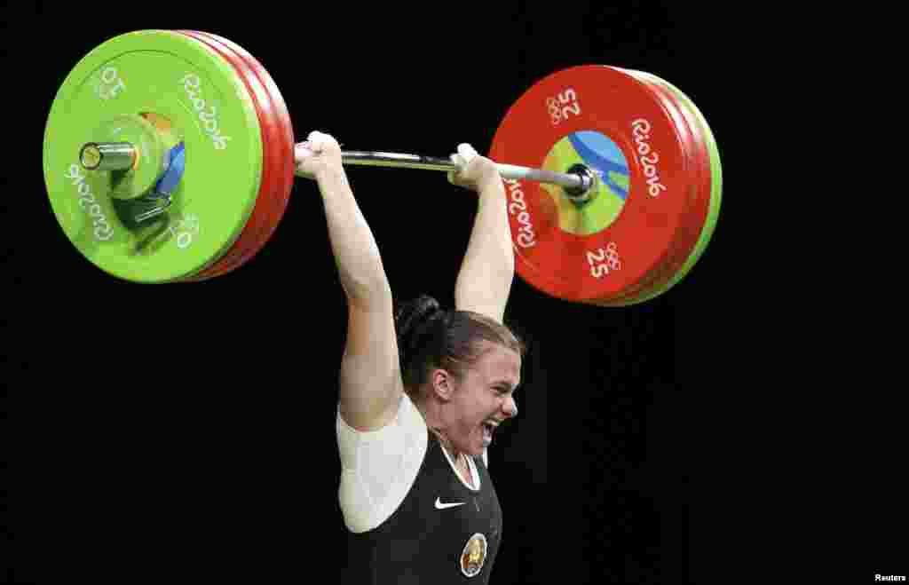 Darya Naumava of Belarus competes in the weightlifting women's 75-kilogram final.