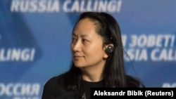 "RUSSIA -- Meng Wanzhou, Executive Board Director of the Chinese technology giant Huawei, attends a session of the VTB Capital Investment Forum ""Russia Calling!"" in Moscow, October 2, 2014"