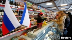 Customers shop at Crimean Farmstead, Russia's first specialized grocery which sells products from annexed Crimea, in the Moscow suburb of Khimki, in January 2015.