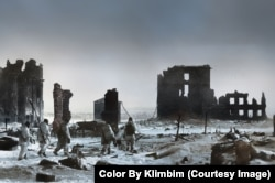 Soldiers in camouflage walk through the moonscape of Stalingrad in 1943.