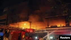 Firemen work to extinguish the fire at the Soma Hotel.